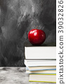 Pile of various books red apple on dark background 39032826