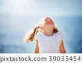 two years old girl standing at the sea 39033454