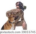Dog handler in gas mask with shepherd dog 39033745