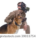Cynologist in gas mask with dog 39033754