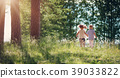 Boy and girl walking in the forest in summer 39033822
