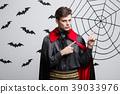Vampire Halloween Concept - Portrait of handsome 39033976