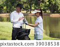 Asian young couple playing golf on golf course 39038538