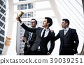 Happy business people with golden trophy cup  39039251