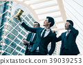 Happy business people with golden trophy cup  39039253