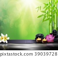 Bamboo, flowers, stone, wax and background on the  39039728