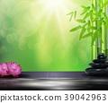 Bamboo, flowers, stone background on the big stone 39042963