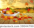 fruits and autumn leaves on a plate on wooden tabl 39044700