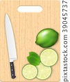 Lemon slices and knife on the chopping board 39045737
