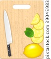 Lemon and leaf slices and knife on the chopping bo 39045983