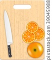 Orange slices and knife on the chopping board 39045988