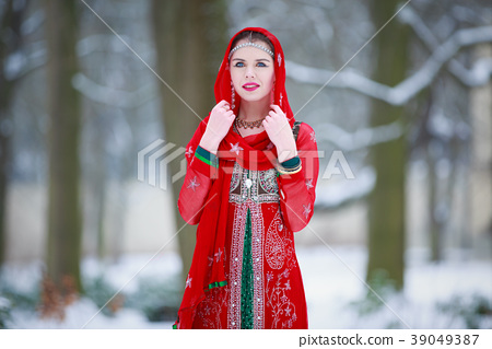 Woman in oriental dress in a winter park 39049387