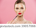 Beauty Concept - Woman applying red lipstick with 39057066