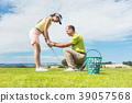 Young woman exercising the golf swing helped by 39057568
