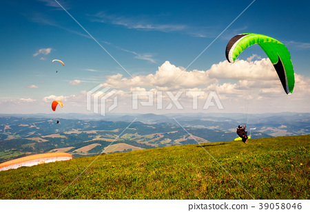 Skydiving  extreme training in mountains 39058046