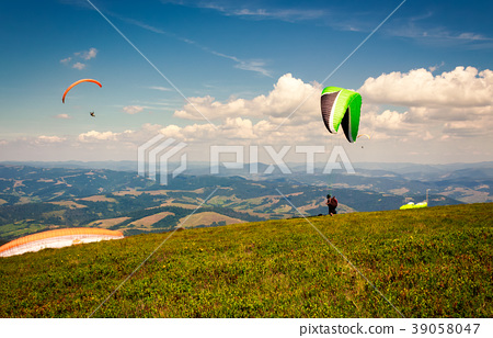 Skydiving  extreme training in mountains 39058047
