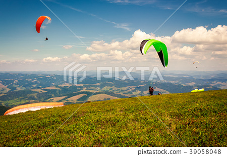 Skydiving  extreme training in mountains 39058048