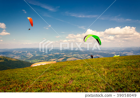 Skydiving  extreme training in mountains 39058049