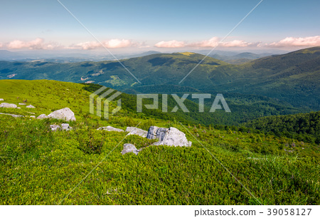 grassy slopes of mountain ridge in afternoon 39058127
