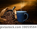 Cup of coffee with smoke and coffee beans 39059564