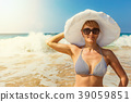 Woman in hat on the beach 39059851
