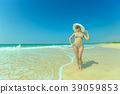 Woman in hat on the beach 39059853