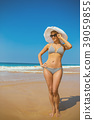 Woman in hat on the beach 39059855