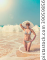 Woman in hat on the beach 39059856
