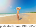 Woman in hat on the beach 39059857