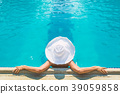 young woman in white hat 39059858