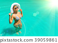 woman relaxing in a pool 39059861