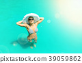 woman relaxing in a pool 39059862