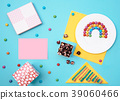 Colorful still life with sweets and present on 39060466