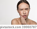Female is suffering from toothache 39060787