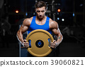 Handsome model young man workout in gym 39060821