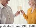 Joyful elderly people celebrating event 39061604
