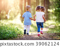 Boy and girl walking in the forest in summer 39062124