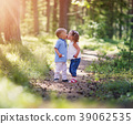 Boy and boy kissing in the forest 39062535