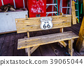 Wooden bench, Route 66, is attracting visitors 39065044
