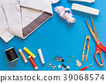 Sewing accessories on blue background 39068574