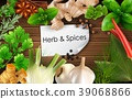 Spices and herbs on brown wooden background 39068866