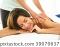 Young woman receiving a back massage in a spa center. 39070637