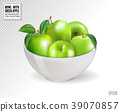 Green apples in white bowl, isolated on 39070857