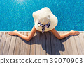 Portrait of beautiful woman relaxing in the pool 39070903