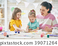 Mother and daughters painting together 39071264