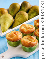 Homemade sweet muffins with pear stuffing. 39084731