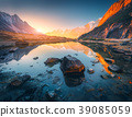 Mountains with illuminated peaks, stones in mountain lake at sunset 39085059