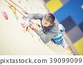 Climber on wall.Young man practicing rock climbing 39099099