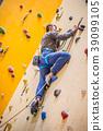 Climber on wall.Young man practicing rock climbing 39099105