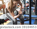 Young asian women lifting dumbbell 39104653
